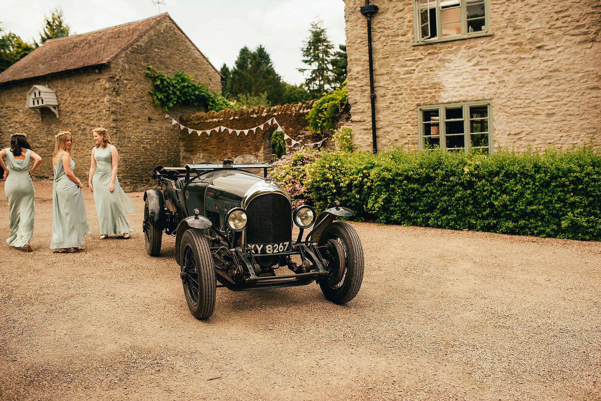 bridesmaids with vintage bentley