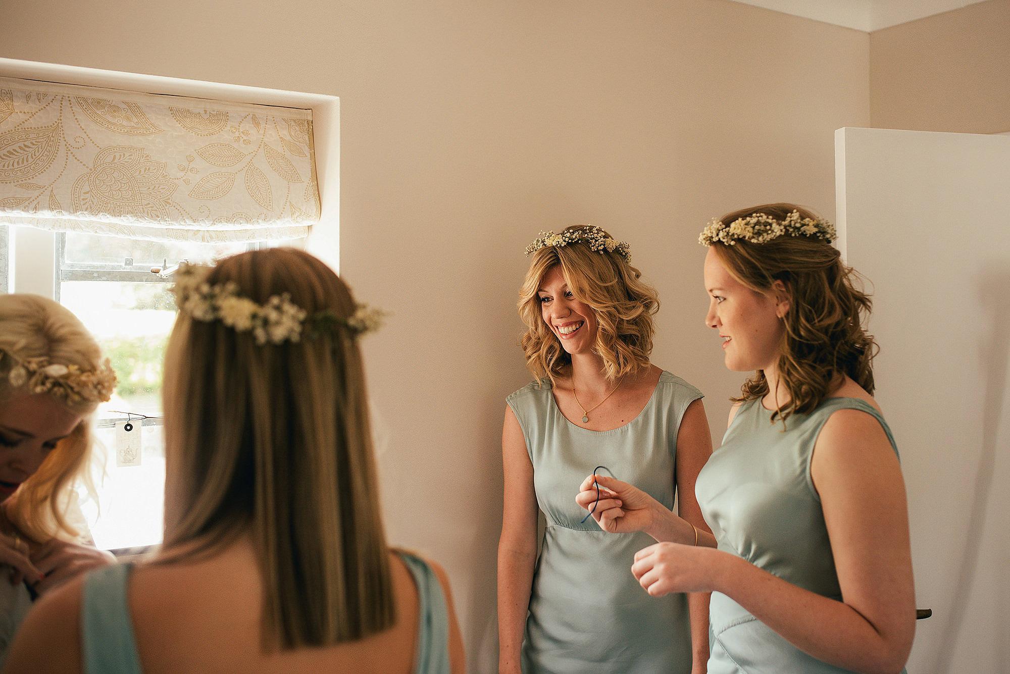 bridesmaids wearing ghost dresses, helping bride