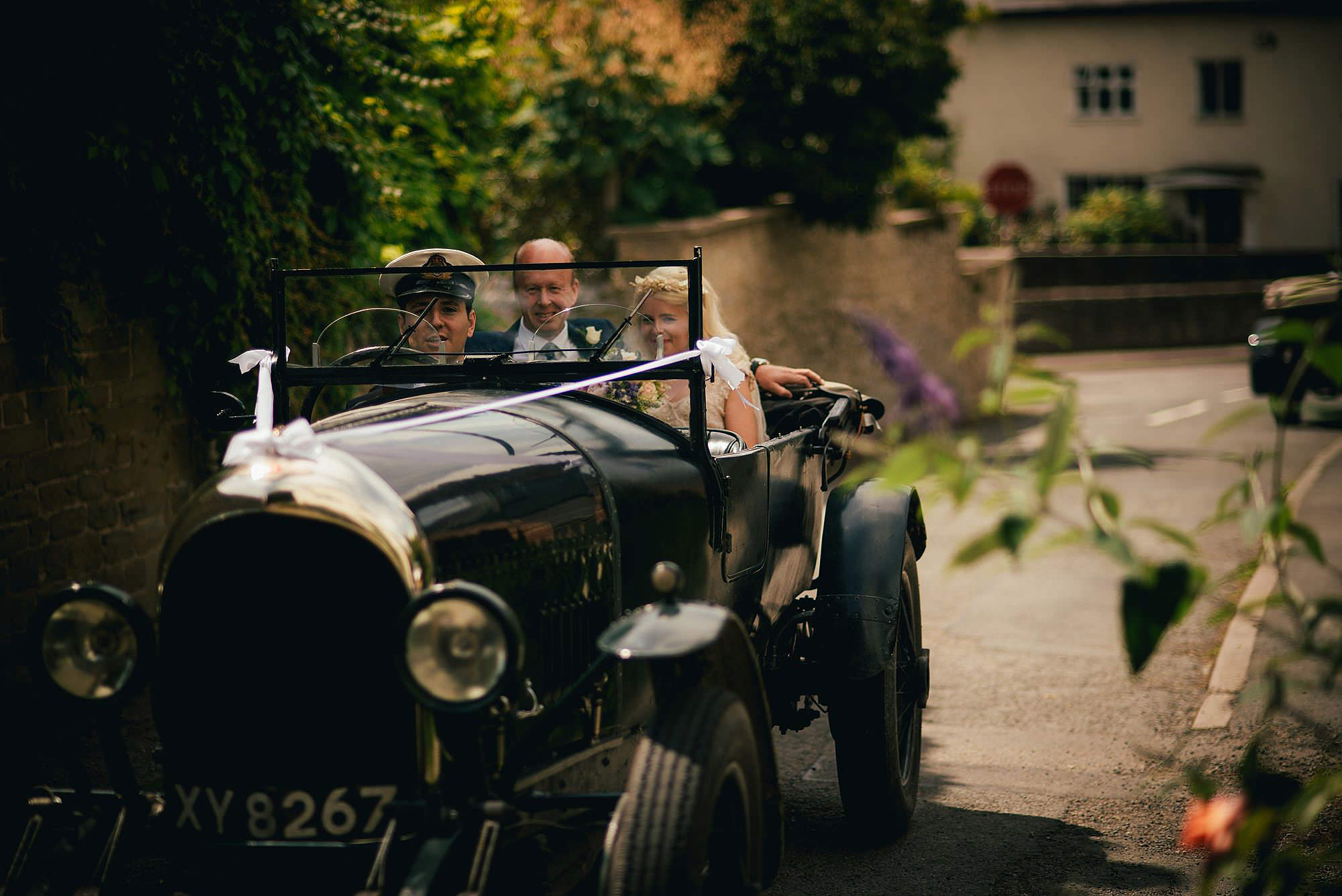 bride and groom in vintage bentley