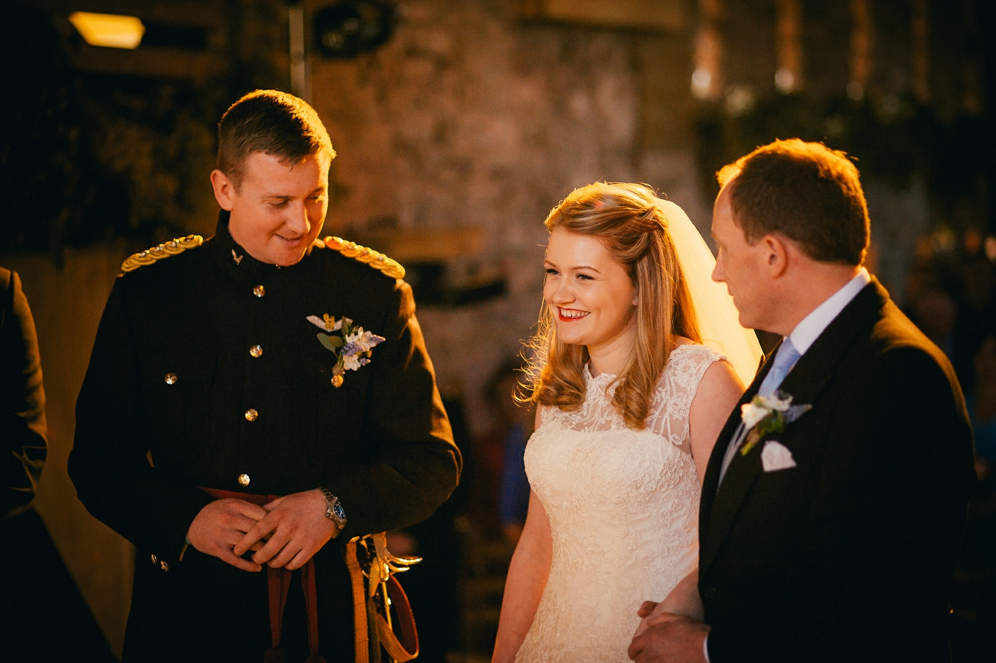 military groom with bride during ceremony