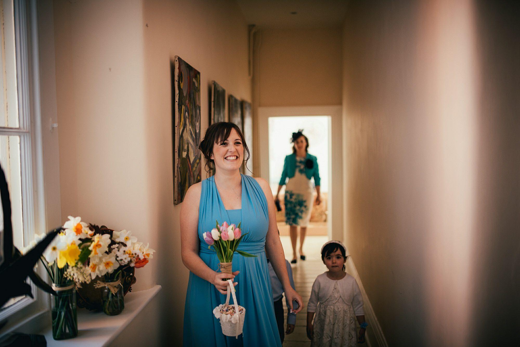 happy bridesmaid seeing bride