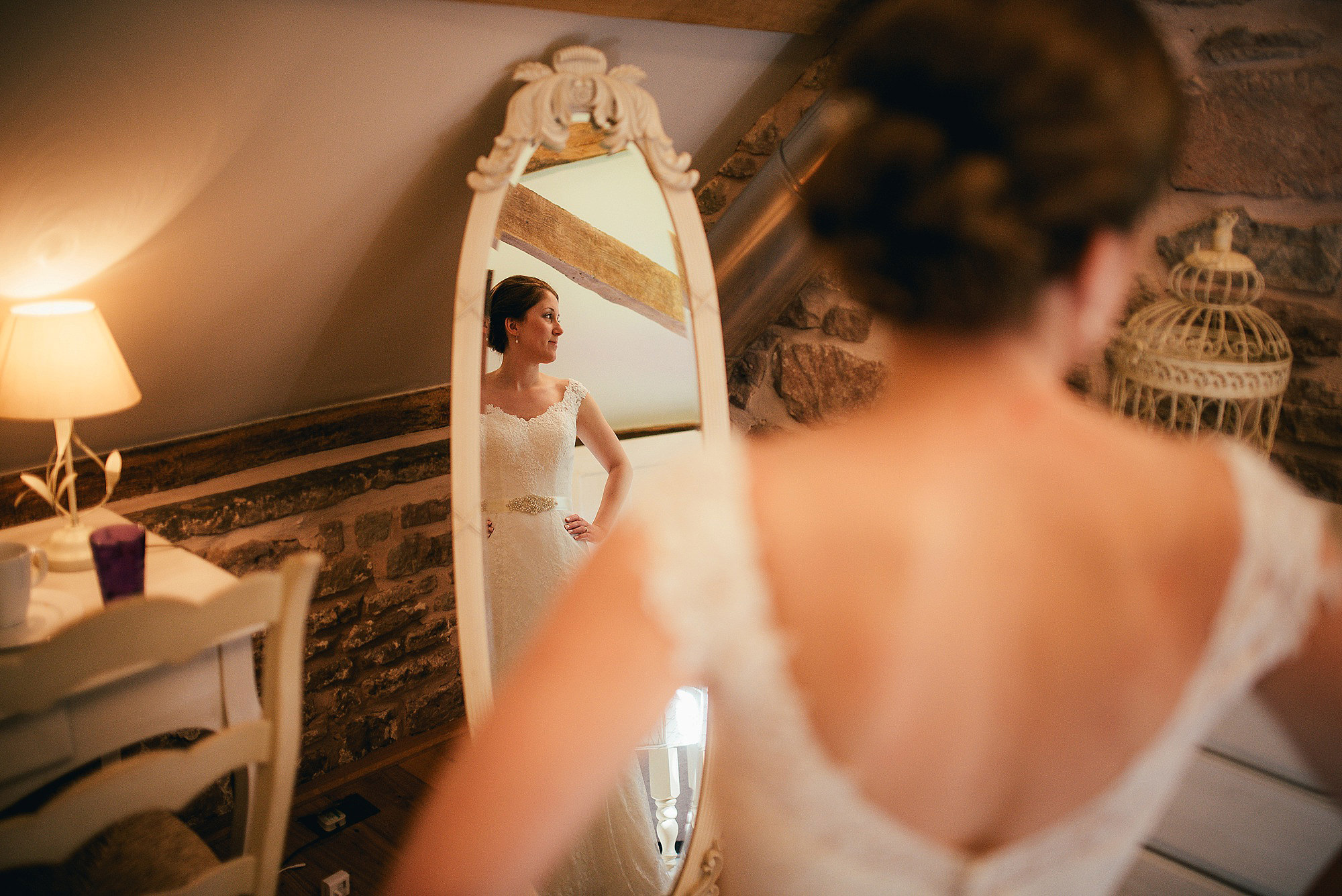 Bride looking out of window at flanesford priory hereford