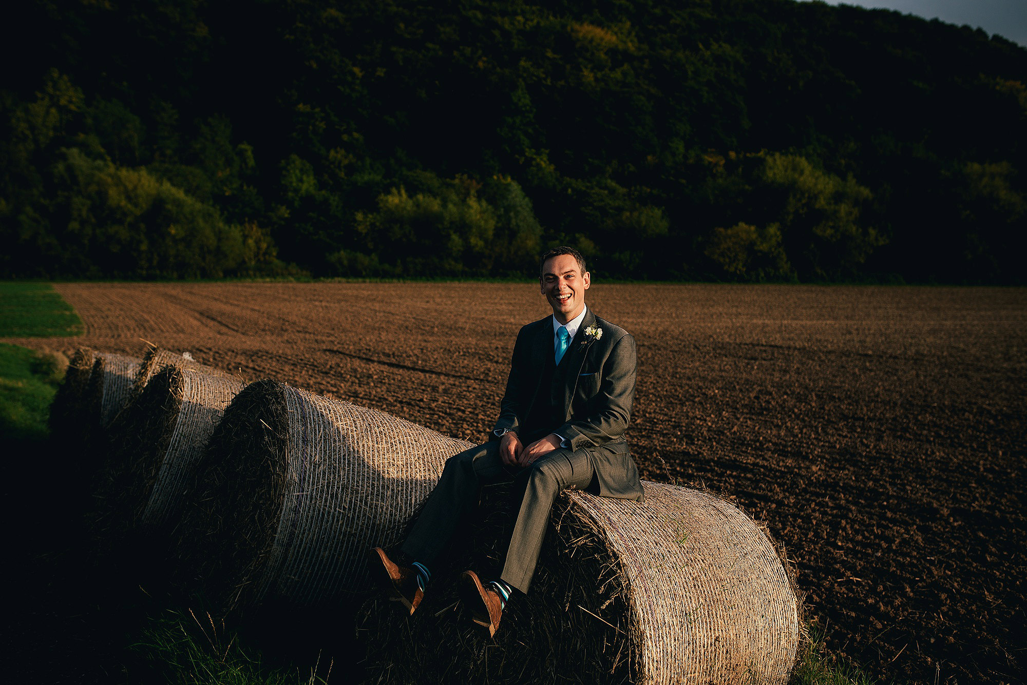 groom on hay bale