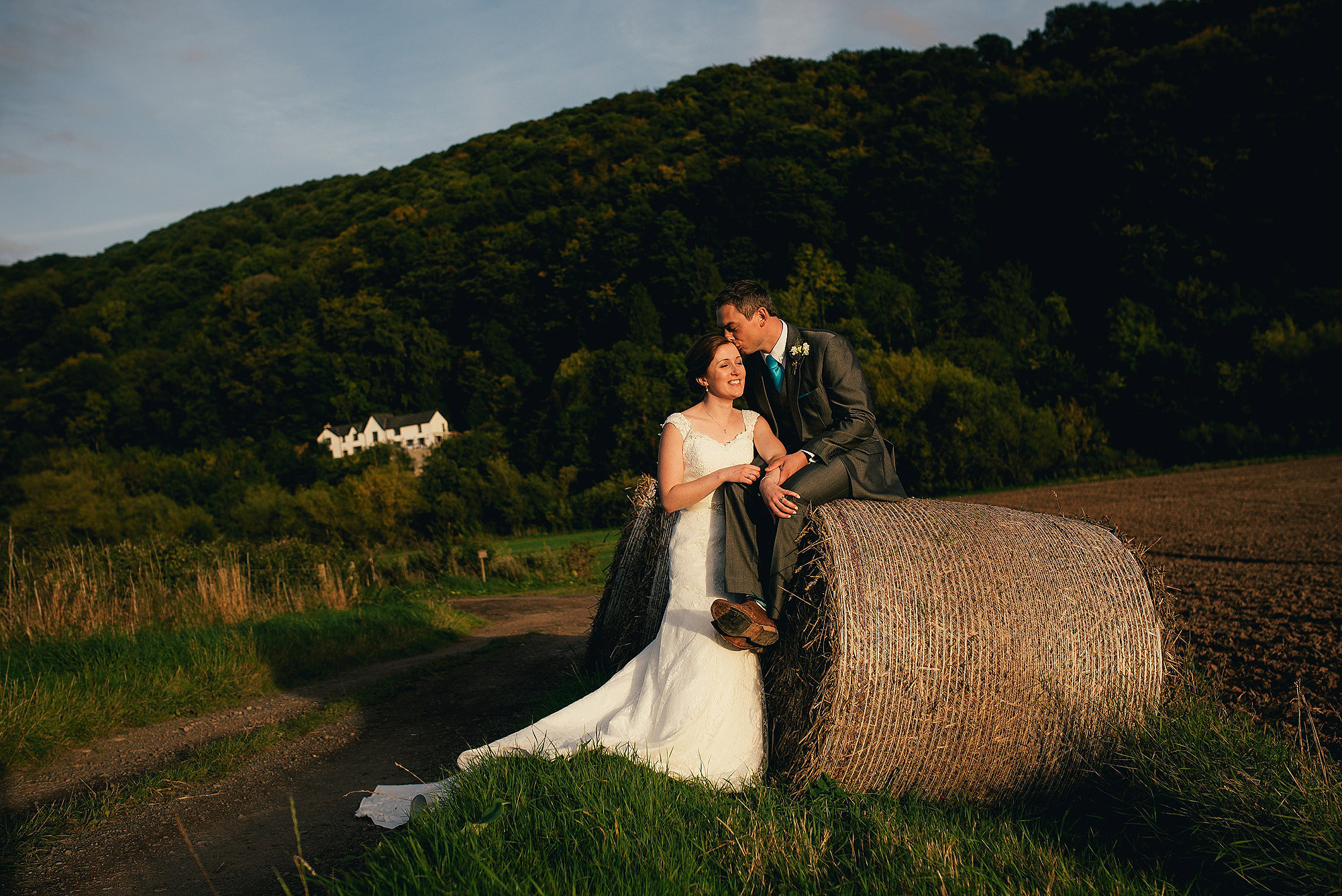 Bride and Groom with a Hay Bale