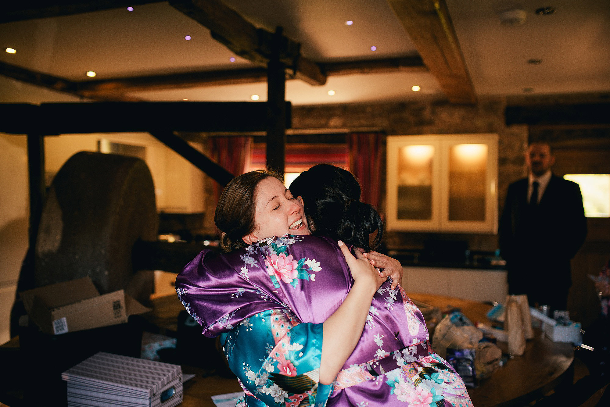Bride and Bridesmaid hugging at flanesford priory hereford