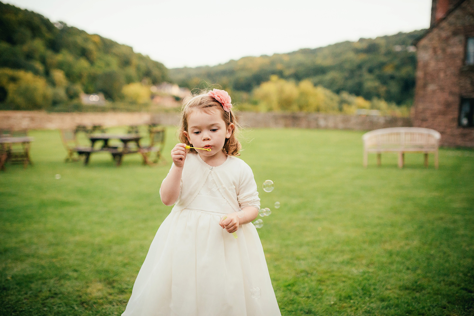 flower girl blowing bubbles