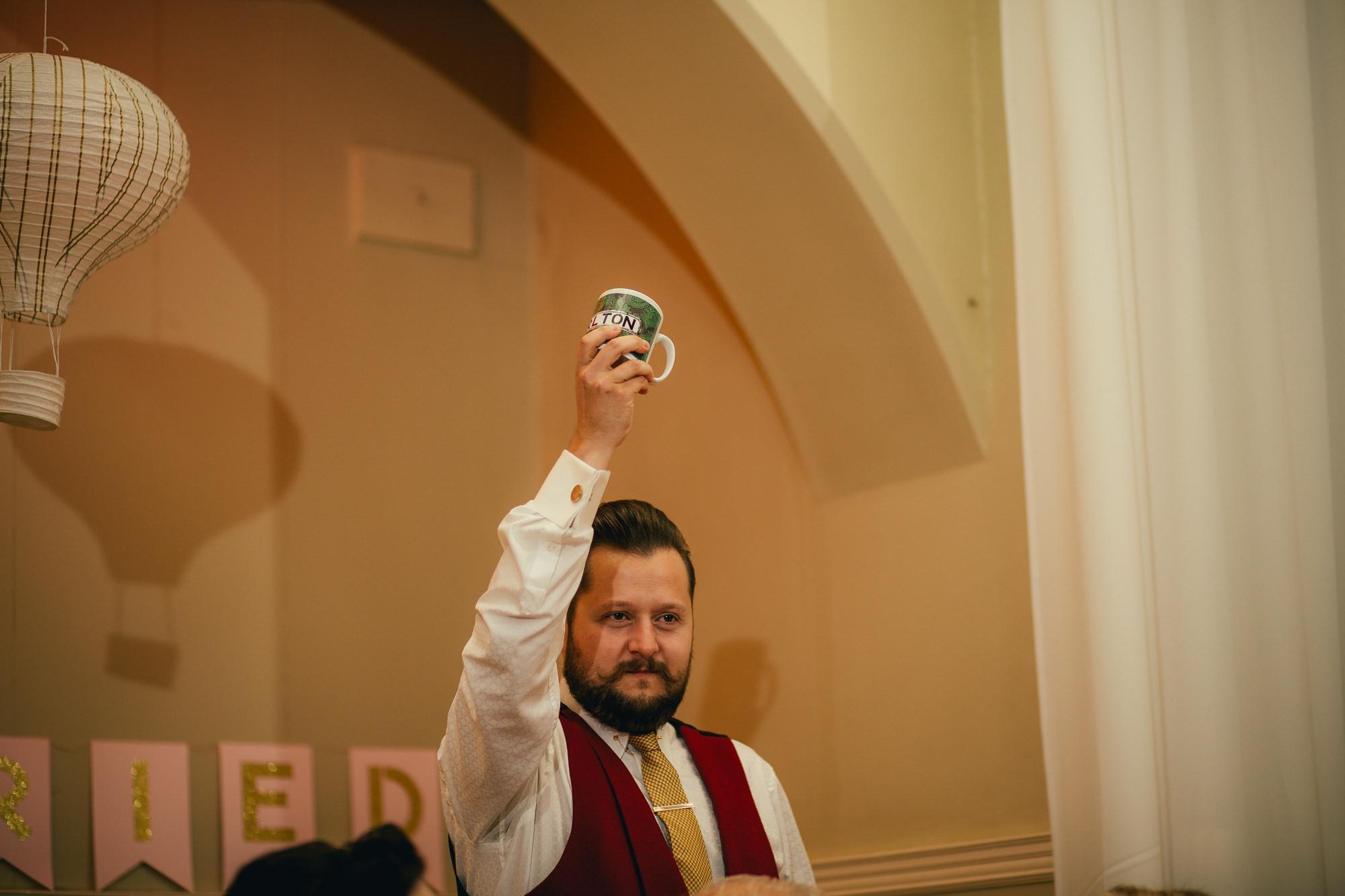 groom holding chorlton mug