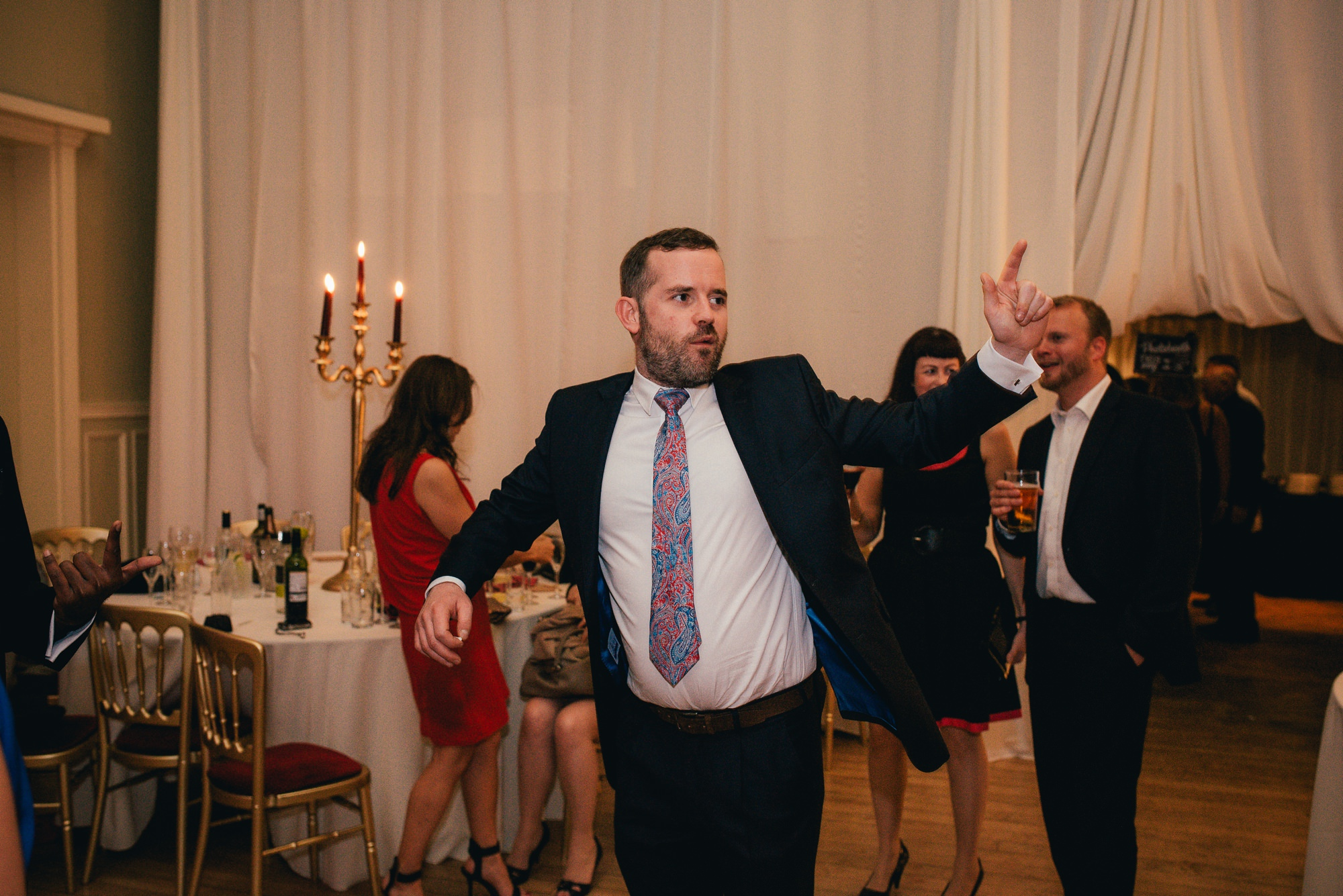 dancing male wedding guest