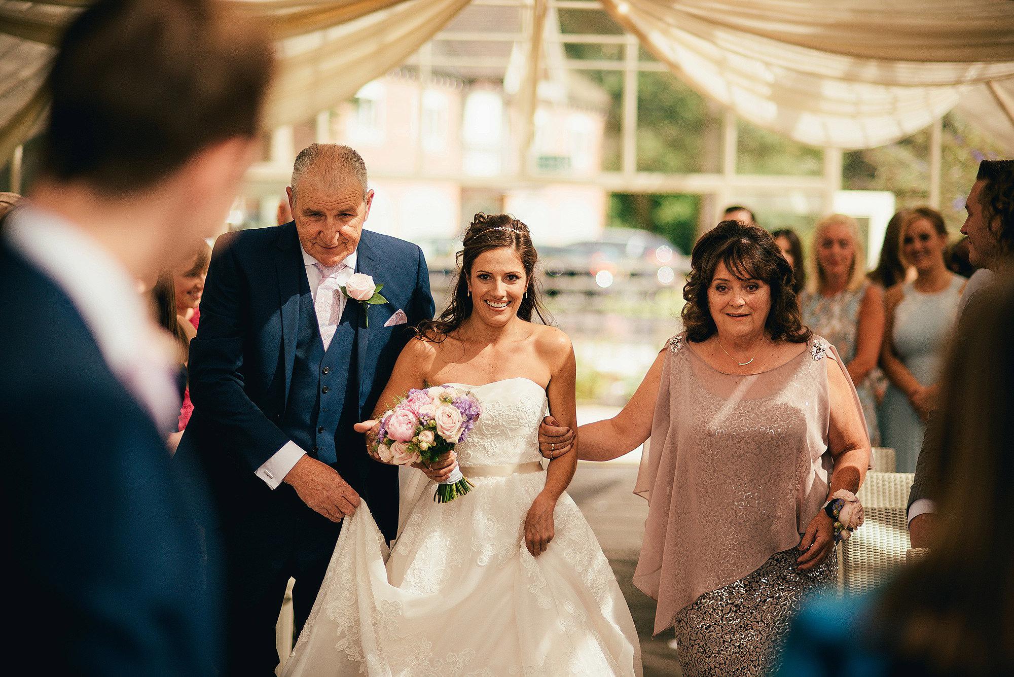 Bride walking down aisle at Abbeywood Estate