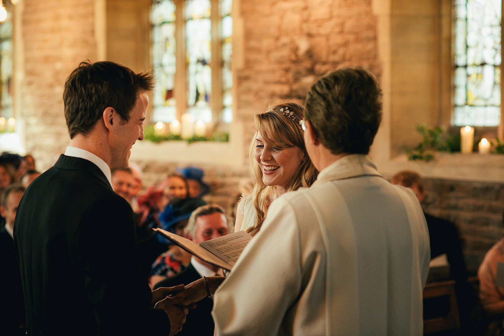happy bride during church ceremony