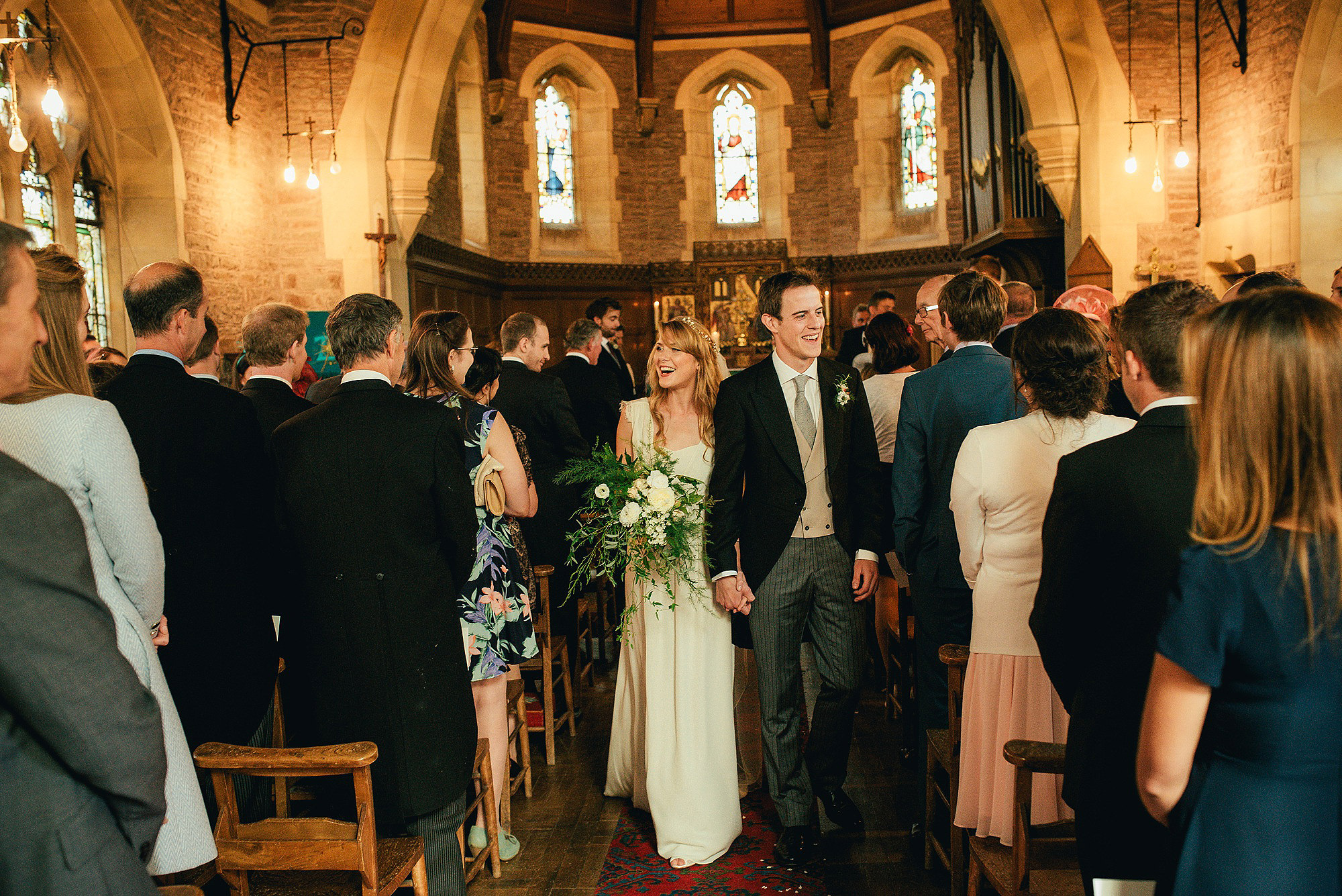bride and groom happy exit from church