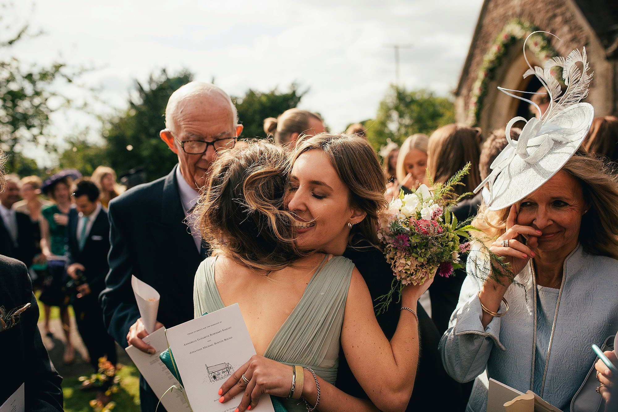 wedding guests hugging