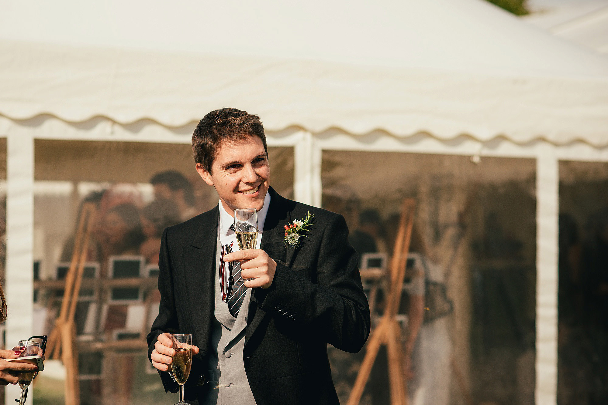 groomsman with champagne