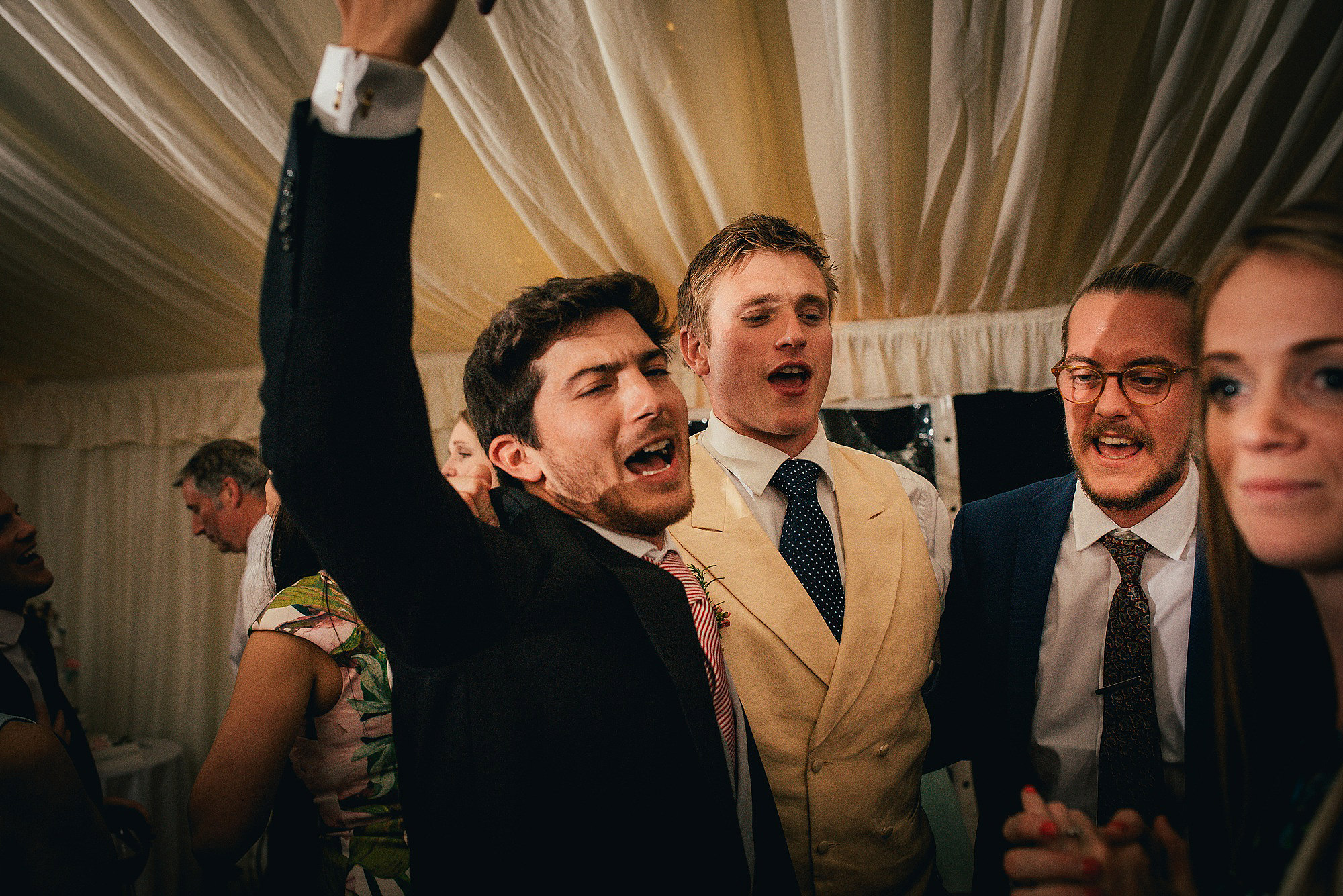 groomsman on dance floor at wedding