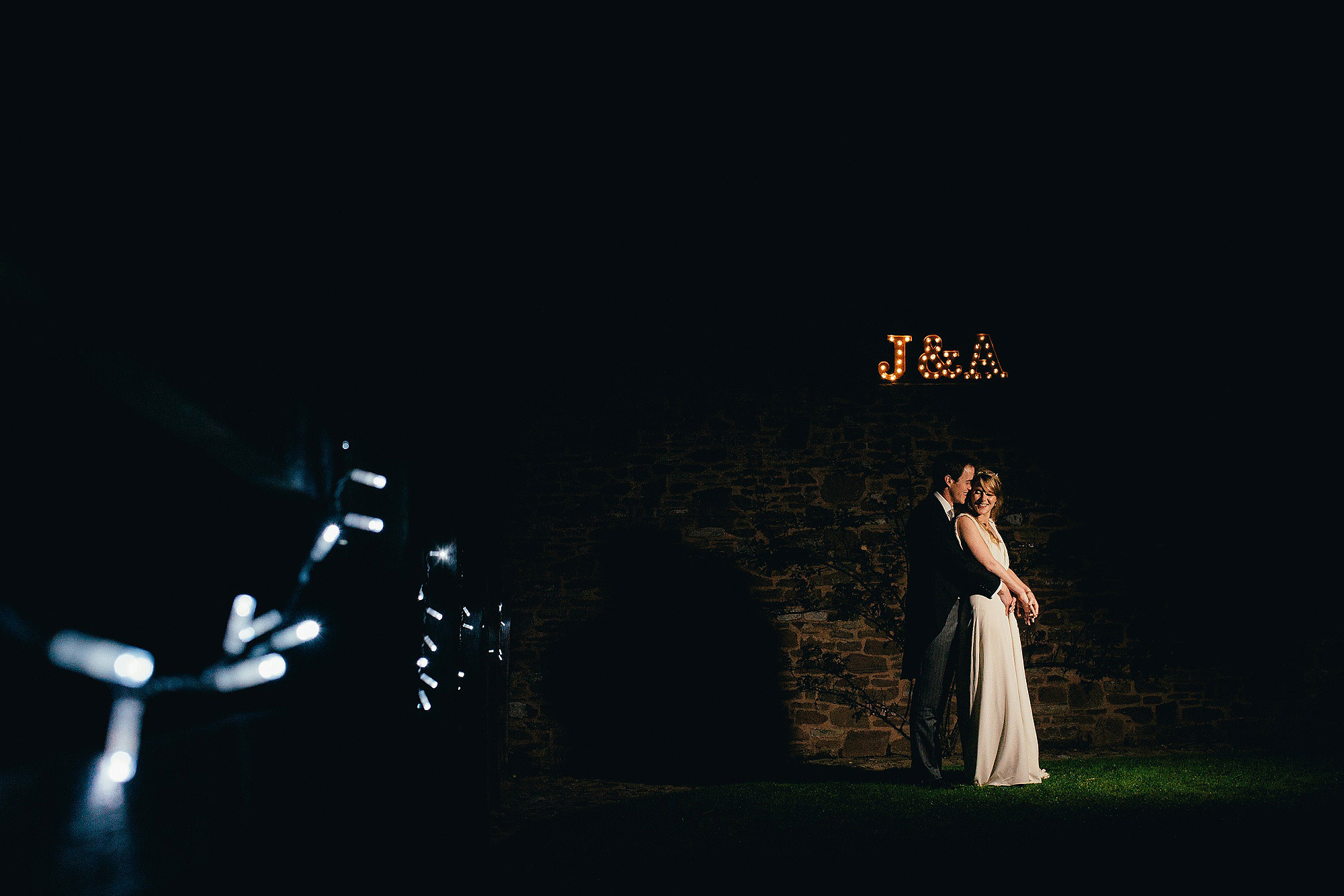 night time portrait for bride and groom fairy lights