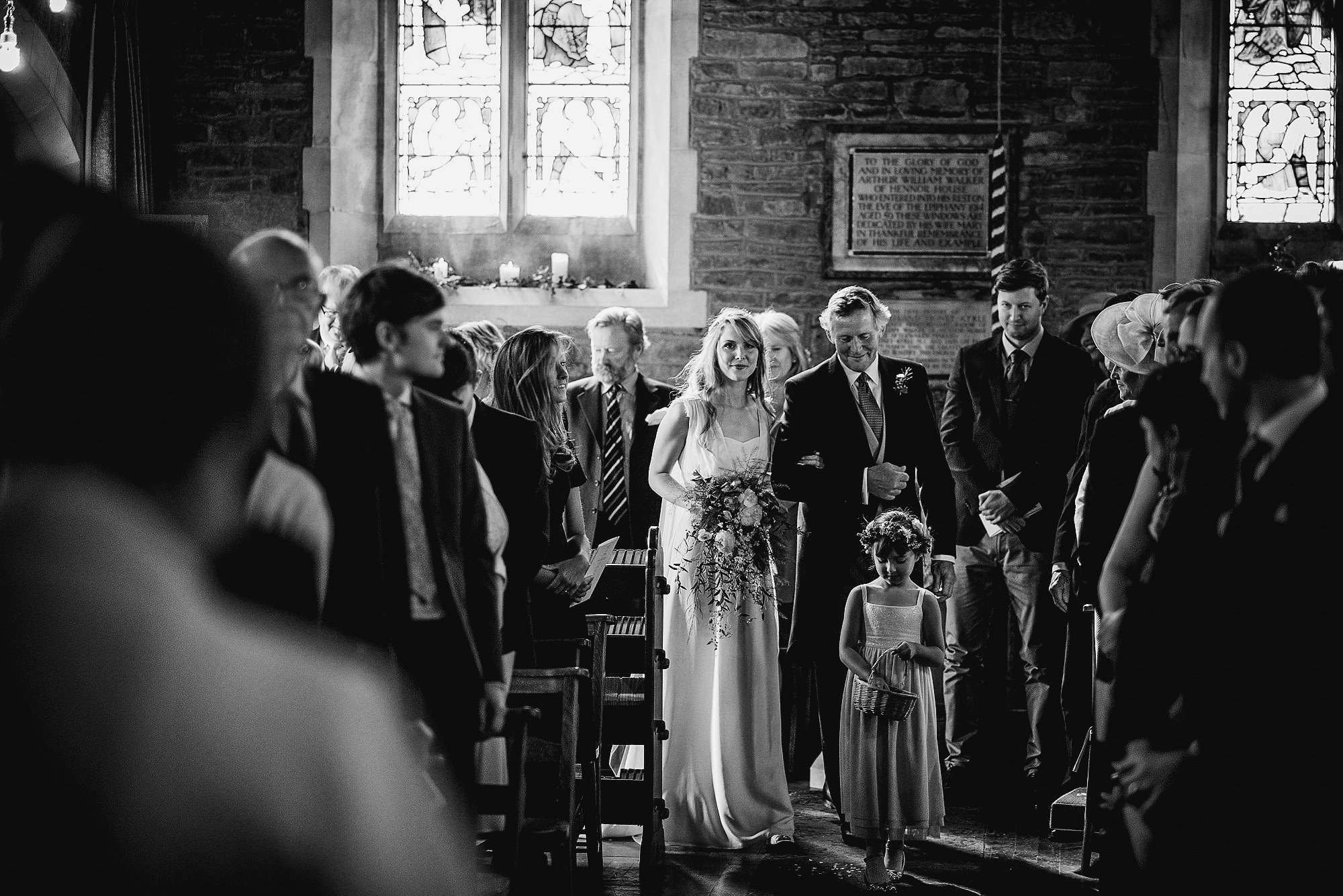 bride and dad walking down aisle with flower girl
