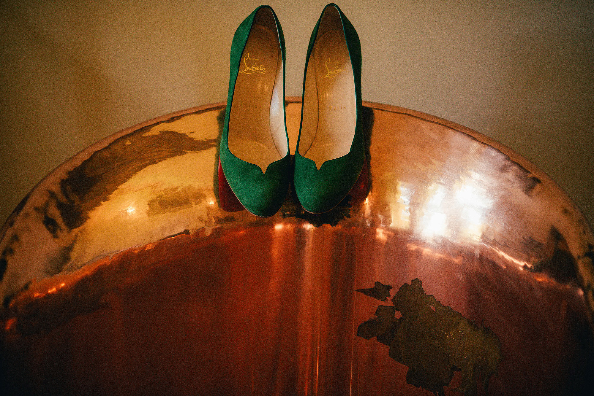 Christian Louboutins green copper bath